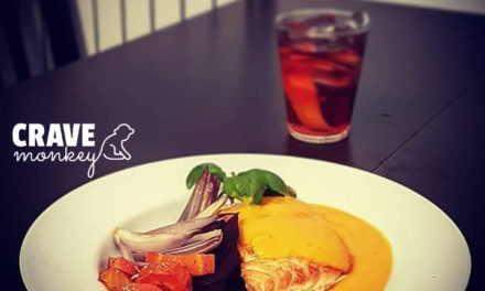 Pan roasted salmon and shallots in a carrot, orange and coconut sauce